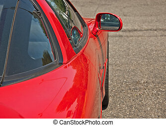 Red Sports Car Side View - This is a closeup side view of a...