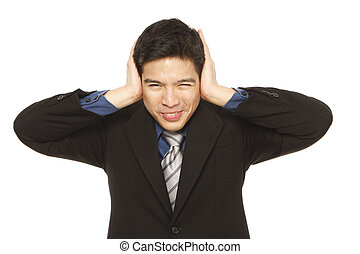 Too Noisy - Young man in business attire covering his ears...