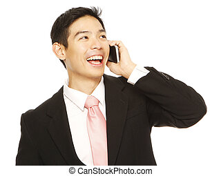 Businessman Calling - A man in business attire holding a...