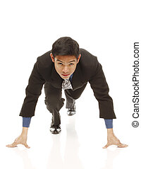 At the Starting Block - A young businessman at the starting...