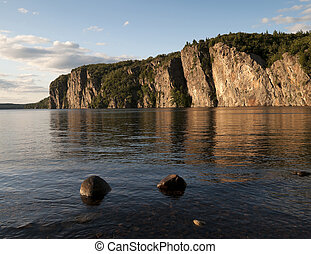 Cliffside Sunset to Bon Echo - Composite image with two...