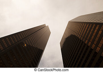 Two Golden Skyscrapers - Two golden colored skyscrapers with...