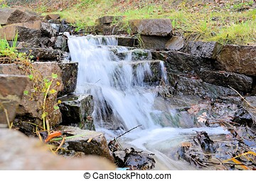 a small waterfall on a creek