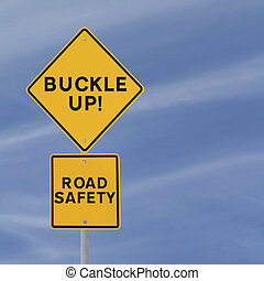 Buckle Up! - Road safety reminder against a blue sky...