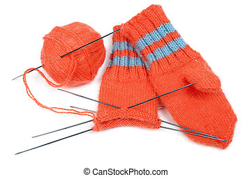 Children\\\'s mittens and ball of a wool with spokes for...