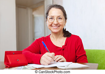 joyful woman fills in the questionnaire at home