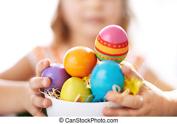 Easter eggs - Photo of colorful Easter eggs held by little...