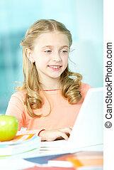 Schoolwork - Portrait of smart schoolgirl sitting in...