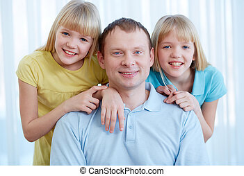 Father with twins - Portrait of happy man with twin...