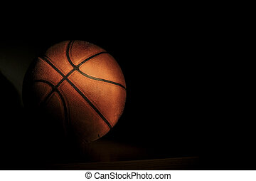 Basketball ball on black background, with room to add your...