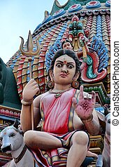 Hindu goddess at colorful temple - A sculpture of a hindu...