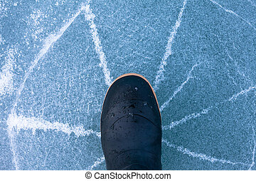 Danger thin ice radially cracks under rubber boot