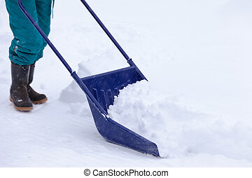 Manual snow removal with snow scoop after blizzard - Manual...