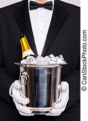 Waiter with Champagne in a silver cooler - Waiter holding a...