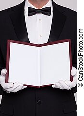 Waiter holding open a blank menu