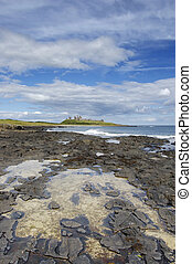 Dunstanburgh Castle and rockpool