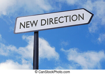 New direction sign - New direction street sign against blue...