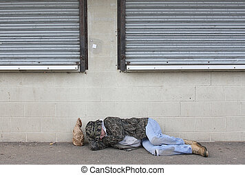 Homeless Man - Homeless man asleep on the sidewalk