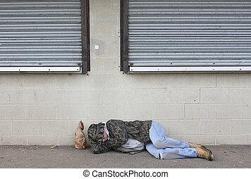Homeless Man - Homeless man asleep on the sidewalk