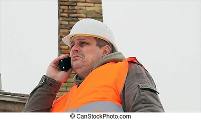 Engineer talking on the cell phone - Engineer talking on the...