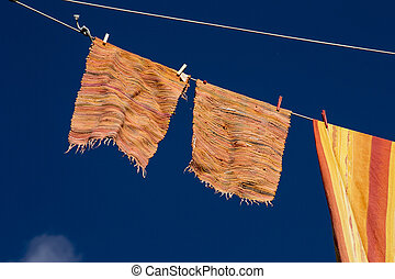 clothes hanging in the blue sky
