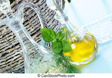 Olive oil, vinegar and basil in the beautiful crystal...