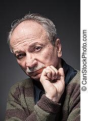 An elderly man - Portrait of an elderly man looks...