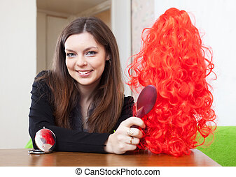 woman with red toupee at home