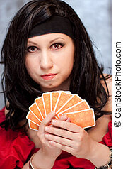 Gypsy woman with cards - Vertical portrait of gypsy woman...
