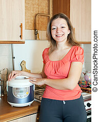 Happy woman with crock pot - Happy woman with electric crock...