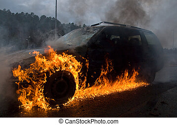 Car on fire - A wreck spinning on burning oil/diesel. A...