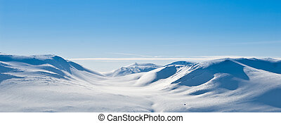 Snowy mountain landscape - A snowy mountain landscape on a...