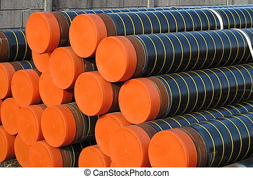 piles of plastic pipes and conduits for transporting gas -...