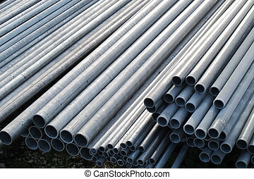 pile of iron pipes for the transport of electrical cables...