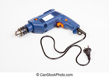 the electric drill laying on white background