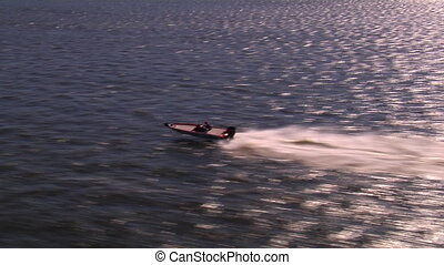 Aerial shot of speed boat flyover