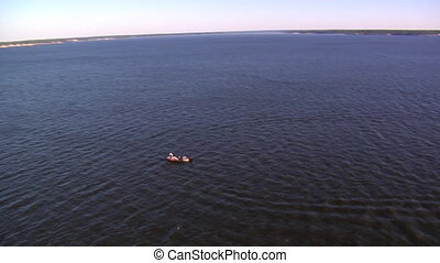 Aerial shot of boat with man fishing