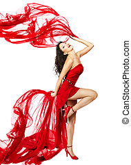 Woman in red dress dancing with fabric flying on a wind flow...