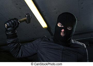 masked criminal with hammer