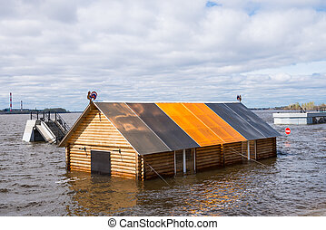 Flooded river - Building under water of flooded river in...
