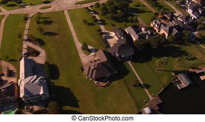 aerial shot of lavish lakefront houses
