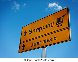 Shopping road sign just ahead.