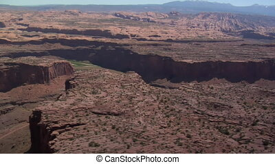 aerial shot of red rock cliffs and Colorado River