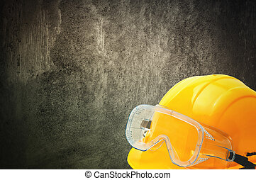 Protective equipment in obsolete gray grunge concrete room