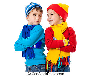 Two emotional kids in winter clothes showing a different...