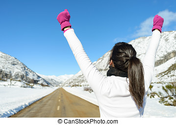 Happy woman runner win on mountain road