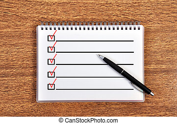 notebook with checklist on table