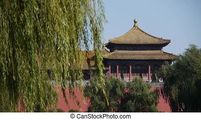 China ancient tower architecture willow in Beijing Forbidden...