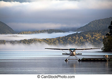 Waterplane ready to go - A landed waterplane - in the foggy...