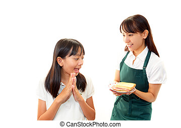 Smiling girl with waitress